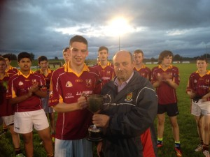 Team captain Evan O'Brien accepts the South Mayo U16 B cup from Ger McHugh, chairman, South Mayo Board